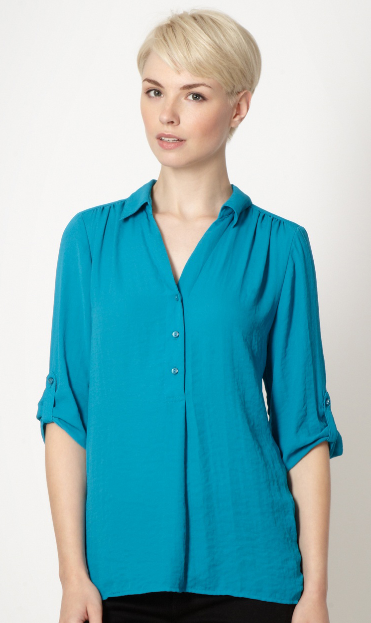 Turquoise With A Three Button Fastening At The Front And